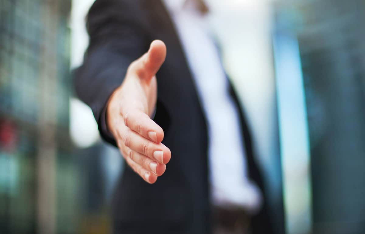 Businessman Extending Hand for Handshake