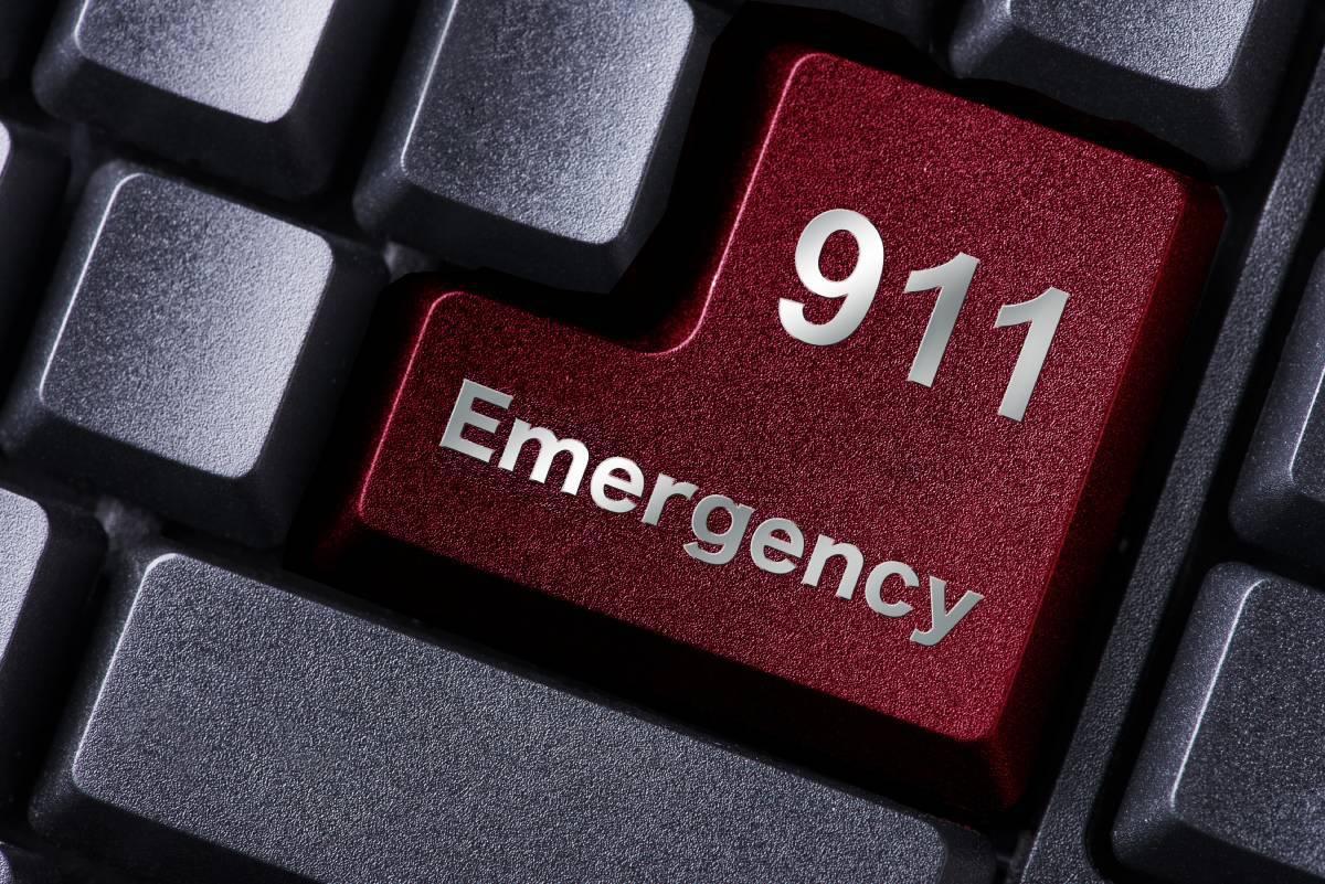 Red key on a keyboard stating 911 Emergency